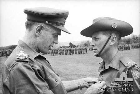 Major Harry Smith receiving the Military Cross from Brigadier David Jackson