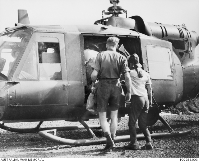 Little Pattie being escorted to chopper for trip back to Vung Tau